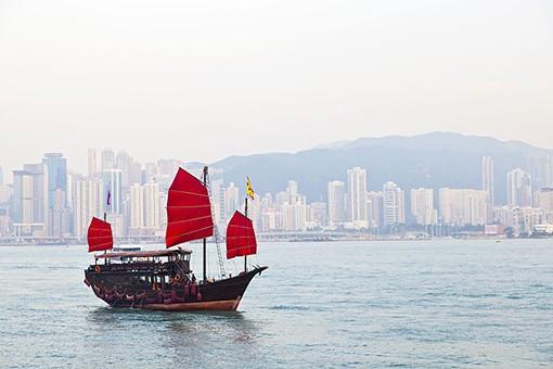 Wooden sailboat sailing in Hong Kong by coloursinmylife