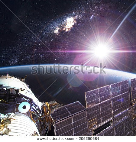 stock-photo-space-station-orbiting-earth-elements-of-this-image-furnished-by-nasa-206290684
